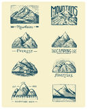 Set of 8 different badges with mountains, engraved, hand drawn or sketch style include logos for camping, hiking Royalty Free Stock Photography