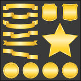 Golden ribbons, shields, stars and badges Stock Photo