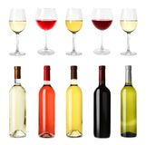 Set with different blank wine bottles and glasses. On white background royalty free stock image