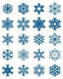 Set of different blue snowflakes. On a white background vector illustration