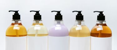 Set of different bottles for beauty, hygiene and health on a white background with reflection Royalty Free Stock Photos