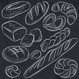 Set of different breads on blackboard Royalty Free Stock Images