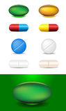 Set of different capsules and medicines Stock Photos