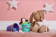 Set of different child toys on floor. Against color wall stock image
