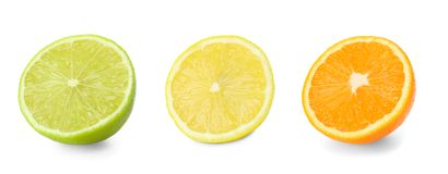 Set with different citrus fruits on white background stock photography