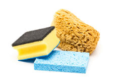 Set of different cleaning sponges over white background Stock Photos