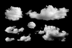 Set of different clouds isolated on black background royalty free stock photos