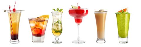 Set with different cocktails and strong drinks on a white background. Isolated stock photography