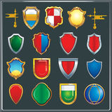 Set of different color and shape of heraldic shields. Set of different color and shape to create the vector coat of arms emblems clans Vector Illustration
