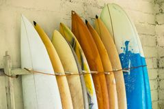 Set of different color surf boards in a stack by ocean.Bali,Indo royalty free stock image