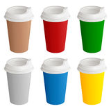 Set of different colored disposable cardboard glasses with plastic covers for coffee or tea Royalty Free Stock Photography