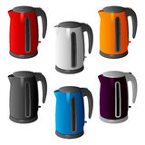 Set of different colored plastic electric kettles on a round base with a handle Stock Photography