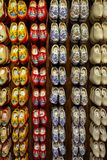 Set of different colorful vintage Dutch wooden clogs on display royalty free stock images