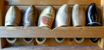Set of different colorful vintage old Dutch wooden clogs stock image