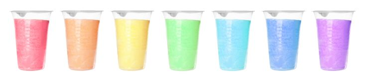 Set of different colorful yummy cotton candy in plastic cups stock photography