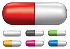 Set of different coloured tablet capsules. Medicine pill illustrations in the form of capsules using gradient mesh Royalty Free Stock Images