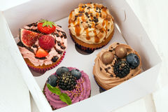 Set of different cupcakes decorated with fresh berries Stock Photo