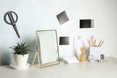 Set of different decorative elements on table against color wall. DIY blogger stock photography