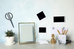Set of different decorative elements on table against wall. DIY blogger. Set of different decorative elements on table against color wall. DIY blogger stock photo