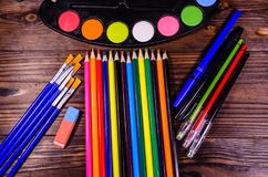 Set of different drawing tools. Watercolor paints, paintbrushes, Stock Images