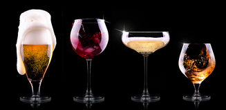 Set with different drinks on black background Stock Photos