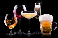 Set with different drinks on black background. Champagne, beer, cocktail, wine, brandy, whiskey, scotch, vodka, cognac Stock Photos