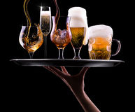 Set with different drinks on black background Stock Photography