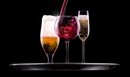 Set with different drinks on black background Stock Images