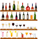 Set of different drinks and bottles on the wall. Stock Images