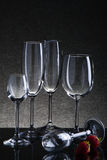 Set with different empty glasses on black background Royalty Free Stock Photo