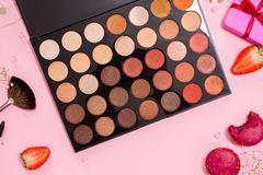 Set of different eyeshadow in the Nude palette, Cute pink flat lay. Glamorous style stock photography