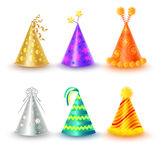 Set of Different Festive Caps in Cartoon Style. On white background. Triangular hood various colors gold purple silver orange green yellow with buboes and stars Royalty Free Stock Images
