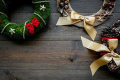 Set of different festive christmas wreath on dark wooden background top view copy space. Set of different festive christmas wreath on dark wooden background top royalty free stock photography