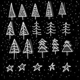 Set of 15 different fir, christmas trees hand drawn style on snowy background Royalty Free Stock Images