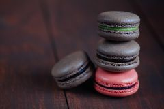 Set of different french cookies macaroons on wooden background. Closeup. Coffee, chocolate, pistachio,raspberry stock image