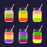 Set of 6 different fresh fruit and berry layered smoothies in mason jars with straw.  Royalty Free Stock Photos