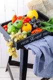 Set of different fresh raw colorful vegetables in wooden tray. Set of different fresh raw colorful vegetables in black wooden tray on white background Stock Image