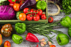 Set of different fresh raw colorful vegetables in the wooden tray. Light background Stock Photos