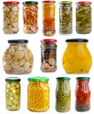 Set of different fruits & vegetables in glass jars. Set of different berries, mushrooms and vegetables conserved in glass jars isolated on the white background Stock Photos
