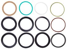 Set of different gaskets isolaled on white background. Oil seals for hydraulic cylinders for Industrial stock photography