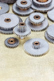 Set of different gear cogwheel on brass metal background Royalty Free Stock Photo