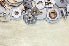 Set of different gears and details of machines on brushed indust Royalty Free Stock Photography