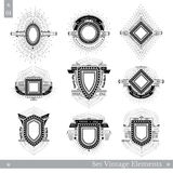 Set of different geometric shields with light ray Stock Images