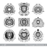 Set of different geometric shields with wreaths. Hipster vintage style templates for business, labels, logos, identity, badges, apparel, shirts, and other Royalty Free Stock Image