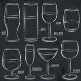 Set of different  glasses on  blackboard Royalty Free Stock Images