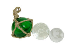 Set of different globes. Green nautical glass float tied with rough rope, crystal ball for seeing into the future with miniature bubbles inside, Crystal globe Stock Photos