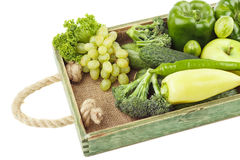 Set of different green fresh raw vegetables and fruits in the wooden tray, isolated Stock Photos
