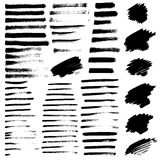 Set of different grunge brush strokes and stains. Stock Photos