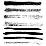 Set of different grunge brush strokes and stains. Stock Images