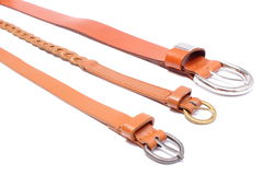 Set of different leather straps on white background Royalty Free Stock Photography